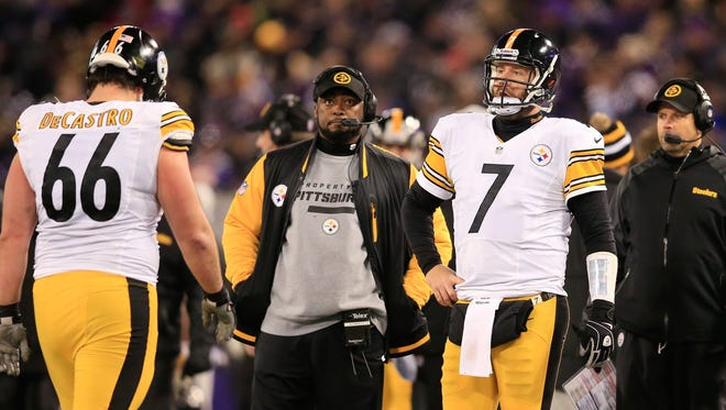 Mike Tomlin, center, and the Steelers lost a heartbreaker in Baltimore on Thanksgiving night.