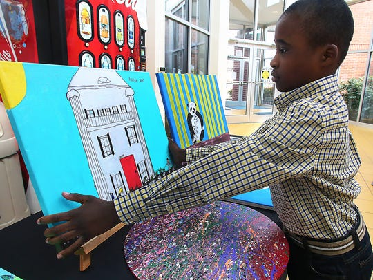 Xavien Marable displays his artwork as part of a previous
