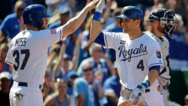 Kansas City Royals' Alex Gordon (4) celebrates with Brandon Moss (37) after hitting a three-run home run during the eighth inning of the first baseball game of a doubleheader against the Minnesota Twins, Saturday, July 1, 2017, in Kansas City, Mo. (AP Photo/Charlie Riedel)