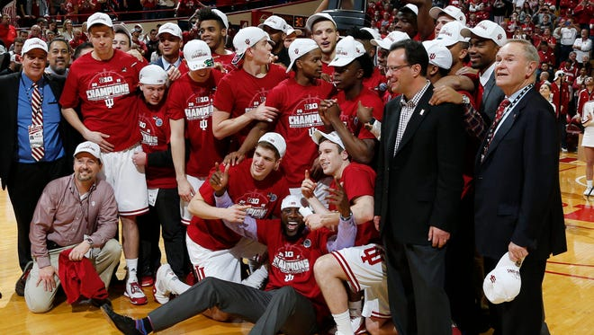 Mar 6, 2016; Bloomington, IN, USA; Indiana Hoosiers pose with the Big Ten championship trophy after defeating the Maryland Terrapins at Assembly Hall. Indiana defeats Maryland 80-62. Mandatory Credit: Brian Spurlock-USA TODAY Sports