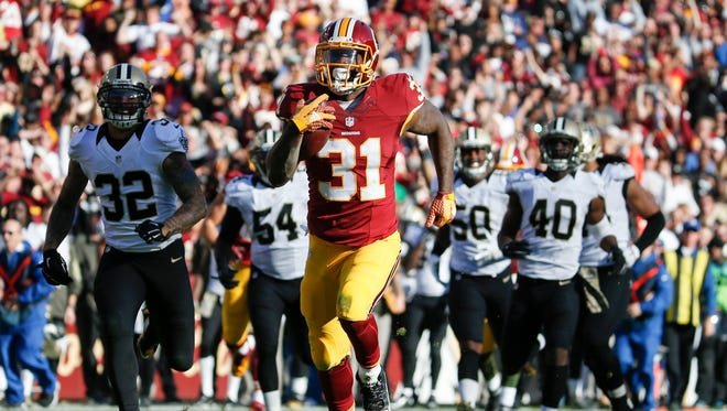 Washington Redskins running back Matt Jones (31) outpaces the New Orleans Saints defense to score a 78 yard touchdown during the first half of an NFL football game Sunday in Landover, Md.