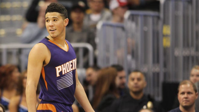 Nov 16, 2016: Phoenix Suns guard Devin Booker (1) walks off the court after being ejected from the game during the second half against the Denver Nuggets at Pepsi Center. The Nuggets won 120-104.