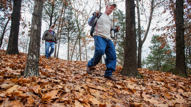 Steve Trostle, right, and Kevin Young walk down the trail at Lake Springfield on Monday, Nov. 28, 2016. Trostle lost his right leg to an infection and is training to hike the Appalachian Trail.