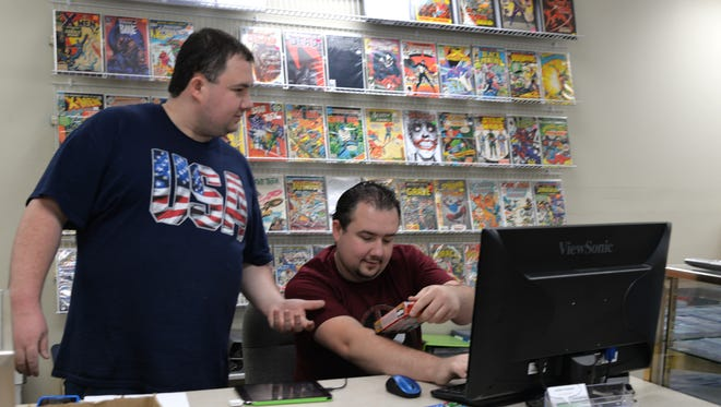 Michael Enck, left, and his brother, James, check pricing on merchandise during the opening of Hooked on Comics at 459 W. Lincoln Avenue, Myerstown, on Saturday, Sept. 3, 2016. The shop is owned by John and Mary Enck. The shop's official grand opening will be Sept. 10 at 12 p.m.