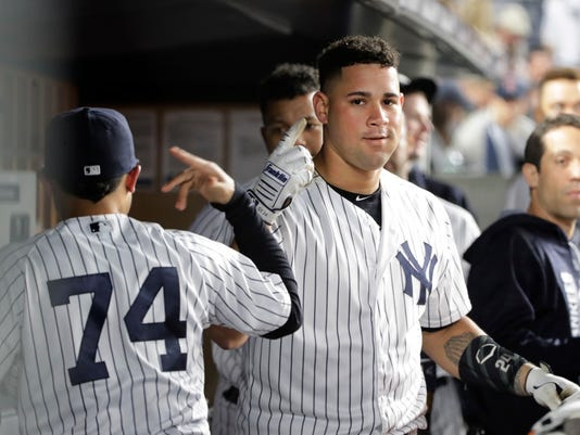New York Yankees' Gary Sanchez celebrates with teammates after hitting a two-run home run during the fifth inning of a baseball game against the Boston Red Sox on Thursday, June 8, 2017, in New York. (AP Photo/Frank Franklin II)