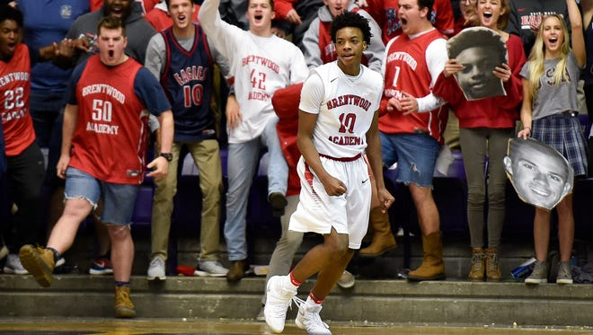 Fans react after Brentwood Academy's Darius Garland (10) scored against Ensworth during the second half of a Division II-AA semifinal game at Lipscomb on Thursday, March 2, 2017.