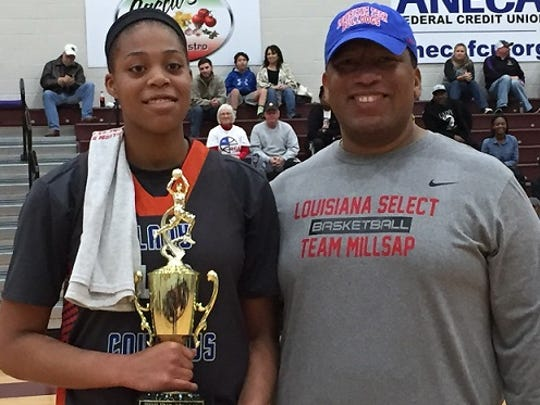 Mike Theus, right, presents Southwood standout Sheniqua Cosby with the MVP trophy during Saturday's Paul Millsap Classic at BPCC.