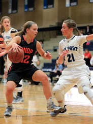 Bay Port's Meg Knutson (21) defends against West De
