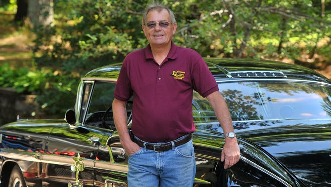 Bill Hussong of Rib Mountain poses at his home with his 1958 Chevrolet Impala.