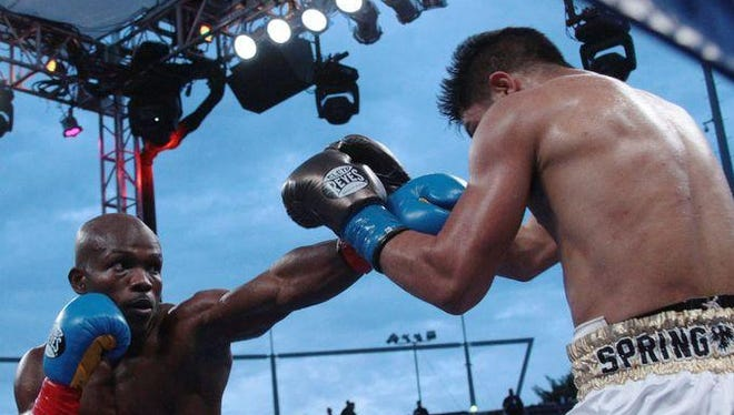 Timothy Bradley extends his left arm toward Jessie Vargas Saturday. Bradley landed 143 power punches in the fight.
