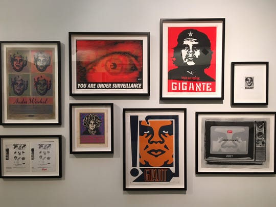 "Shepard Fairey's ""Gigante"" and ""Giant"" posters dominate"