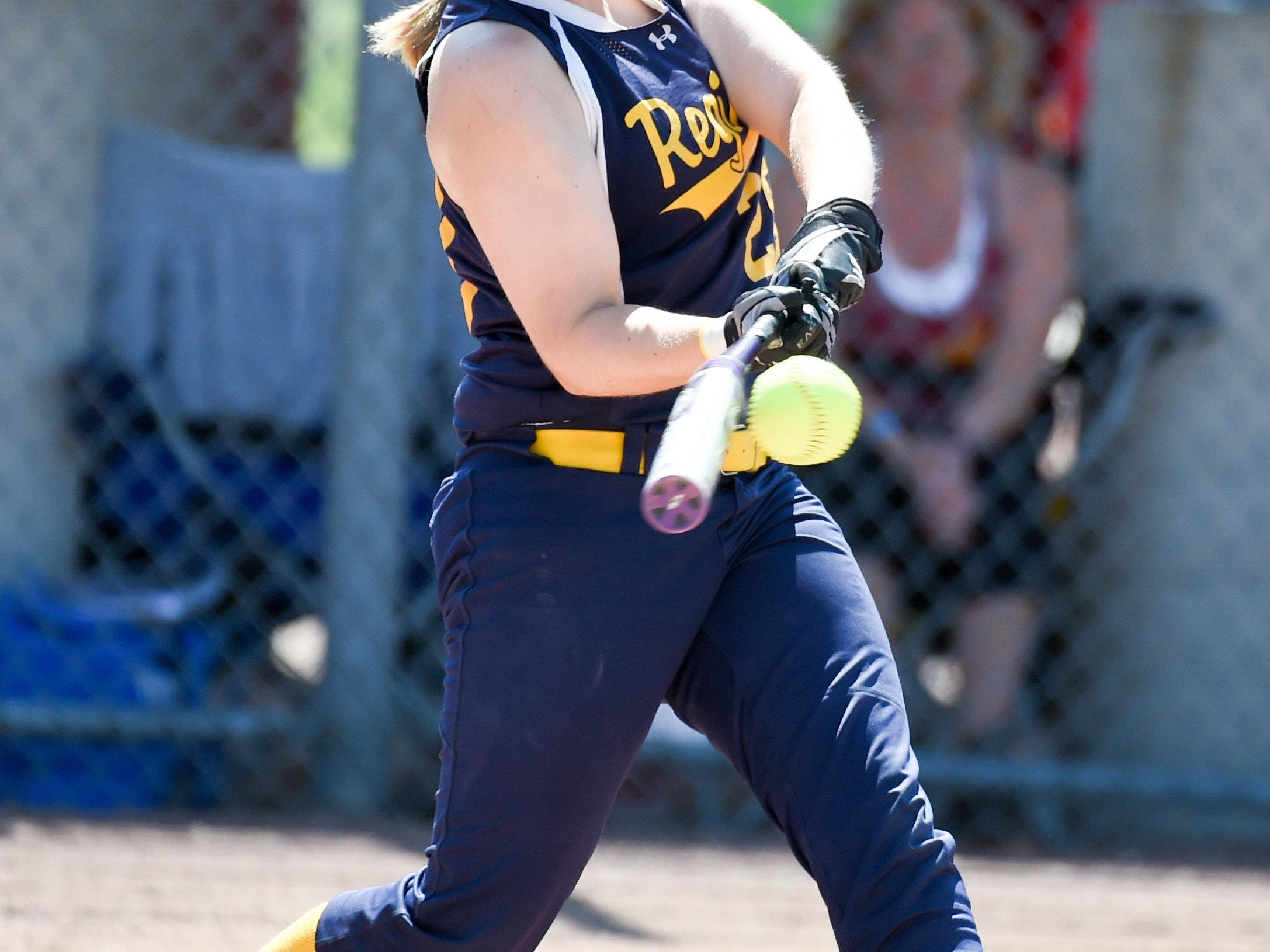 Iowa City Regina's Morgen Goedken (28) gets a hit while at bat in a game against Durant on Tuesday, July 21, 2015, during the Class 2-A quarterfinals.