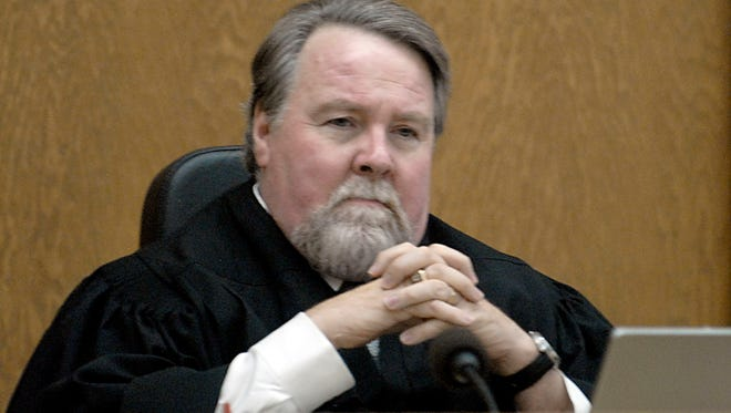 Judge Patrick Flanagan sits in court Thursday May 6, 2010 while Reed High School students visited his court room.
