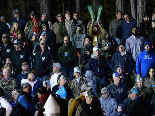 Fans greet each fisherman before starting the opening day of the 2018 GEICO Bassmasters Classic on Lake Hartwell in Anderson on Friday.