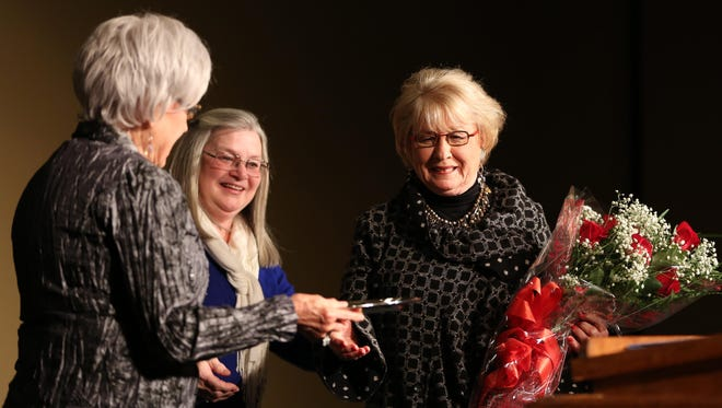 Anita Kay Archer (right) is awarded Woman of the Year by Pat Alford (left) and Diann Robinson (middle) at the Carl Grant Center at Union University on Monday evening