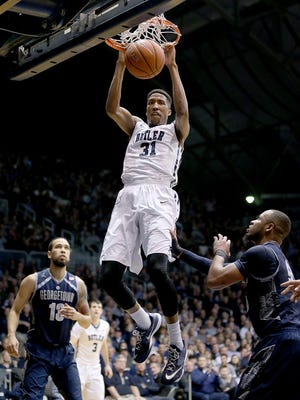 Butler forward Kameron Woods slams down two points over Georgetown  guard Jabril Trawick (55) in the first half of their game, Tuesday at Hinkle Fieldhouse.