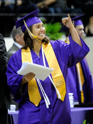Wylie graduate Malia Lynn Williams salutes the crowd as she walks across the stage during Wylie High School's commencement ceremony on Friday, May 27, 2017, at Abilene Christian University's Moody Coliseum.