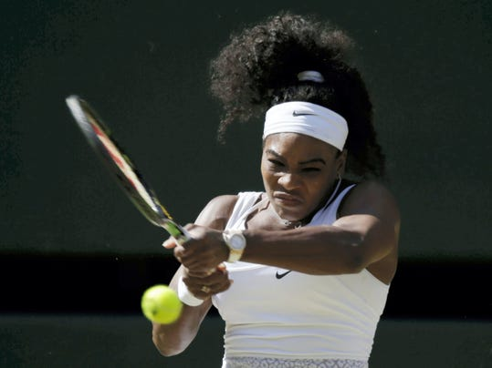 Serena Williams of the United States returns a shot to Maria Sharapova of Russia on Thursday during their women's singles semifinal match at the All England Lawn Tennis Championships in Wimbledon, London,.