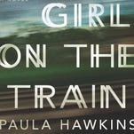"Book cover jacket image for the novel ""The Girl on The Train"" by Paula Hawkins."