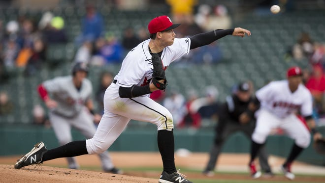Opening day starter Steven Brault throws with a runner on base during the first Indianapolis Indians game of the season, vs. the Toledo Mud Hens, Victory Field, Indianapolis, Thursday, April 6, 2017.