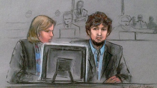 In this courtroom sketch, Dzhokhar Tsarnaev, right, and defense attorney Judy Clarke are depicted watching evidence displayed on a monitor during his federal death penalty trial on March 9, 2015, in Boston.