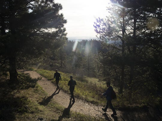 A group of Coloradoan sports reporters hike down the Horsetooth Rock trail after a sunrise hike Thursday, April 14, 2016.