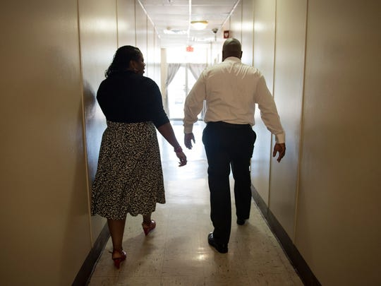 April 13, 2017 - Tracey and Keith Millbrook walk down a hallway at Barron Heights Transitional Center where Keith is executive director. The center provides housing and other services for homeless veterans. The couple also founded We Are Family Community Development Corporation which offers adult education assistance and family mentoring services. The pair struggled with substance abuse before entering a mentoring program at LeMoyne-Owen College.