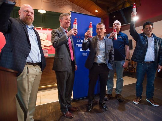Gov. John Hickenlooper toasts to Colorado with Budweiser executives and Fort Collins brewery staff in the Biergarten tasting room at Anheuser-Busch in Fort Collins on Tuesday, May 23, 2017. The brewery announced about $28.5 million in investment in its Fort Collins facility.