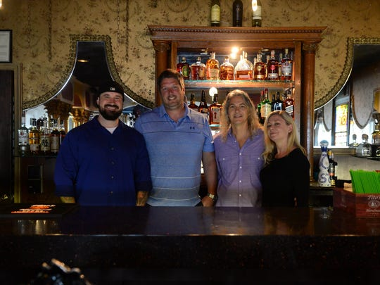 Ocean 13's Co-Owners Jeremy Brink, Nicholas Sikora, Jamie Stewart and Steve Bowers pose for a photo behind their new Whiskey Bar on Friday, May 18, 2018 in Ocean City, Md.