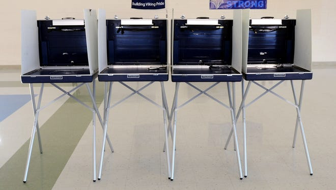 Voting booths sit ready Monday, Nov. 2, at Marysville Middle School.