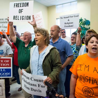 Supporters of Kim Davis chant in support of the Rowan