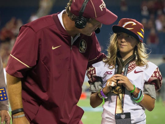 Florida State head coach Jimbo Fisher talks to his son, Ethan, before a Seminole football game.