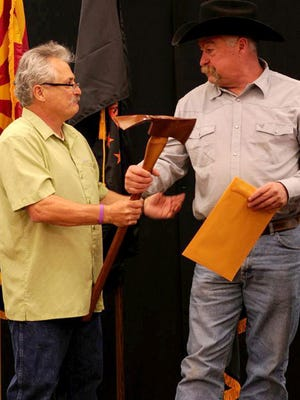 Tony Sciacca, left, coordinator of the Arizona Wildfire and Incident Management Academy, awards the academy's 2013 Firefighter of the Year Award to Gary Cordes of Central Yavapai Fire District in March. Cordes received the award for helping rescue residents during last summer's Yarnell Hill Fire.