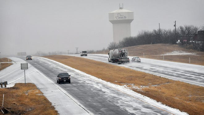 Traffic moves slowly along Highway 287 just west of Wichita Falls Wednesday morning as blowing sleet and freezing rain moved into the area. The Department of Public Safety worker at least two rollover accidents between Iowa Park and Electra Wednesday morning as road conditions quickly deteriorated.