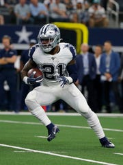 Dallas Cowboys running back Ezekiel Elliott (21) finds running room against the Miami Dolphins in the first half of a NFL football game in Arlington, Texas, Sunday, Sept. 22, 2019. (AP Photo/Michael Ainsworth)