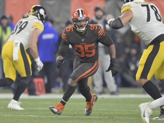 Cleveland Browns defensive end Myles Garrett (95) rushes the quarterback in the third quarter of an NFL football game against the Pittsburgh Steelers, Thursday, Nov. 14, 2019, in Cleveland. The Browns won 21-7. (AP Photo/David Richard)