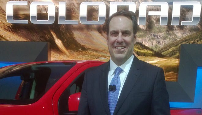 Mark Reuss, president of General Motors U.S. operations, beams over prospects for the 2015 Chevrolet Colorado midsize pickup unveiled at the LA auto show Nov. 20. On sale next fall, the truck has the features and appearance of a full-size model, seen as an advantage.
