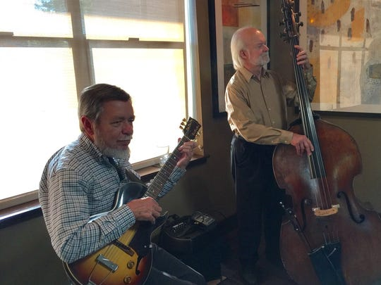 Classic jazz guitarist Bernie Baker performs with upright