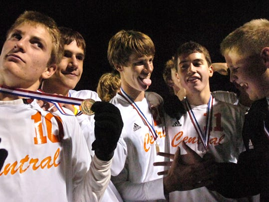 Eric Detzel, left, and other members of the Central York boys' soccer team celebrate their gold medals after the Panthers' 1-0 victory against Red Lion in the 2005 YAIAA boys' soccer championship.