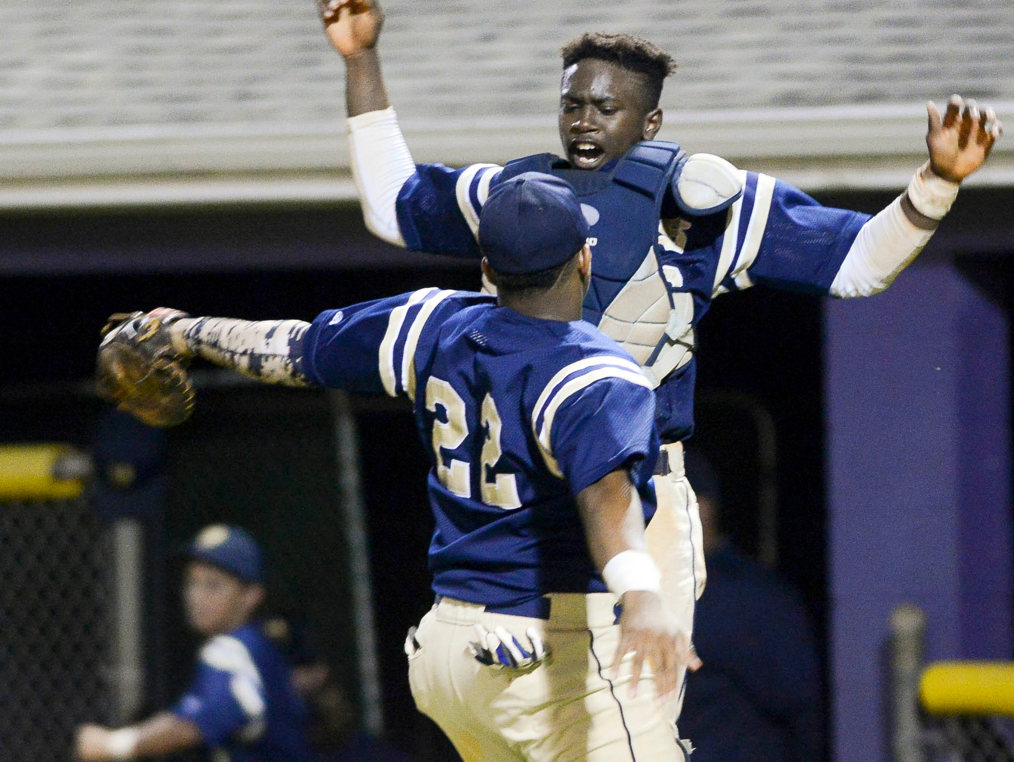 Holy Trinity's Jacquel Perry and Tony Jenkins celebrate a score during Tuesday's district playoff game in Port St. John.