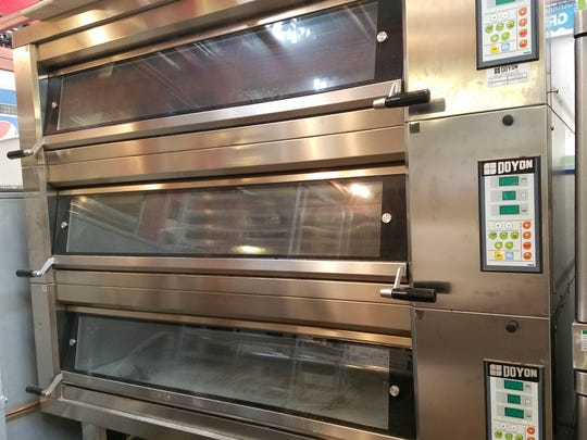 The 900-pounds steam injecting, stone deck oven at
