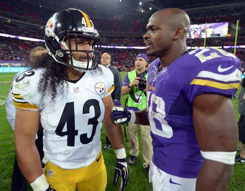 NFL titans Troy Polamalu (43) of the Pittsburgh Steelers and Adrian Peterson of the Minnesota Vikings met Sept. 29 as the NFL returned to London and Wembley Stadium. The Vikes  outlasted the Steelers 34-27, thanks in large part to Peterson's efforts.