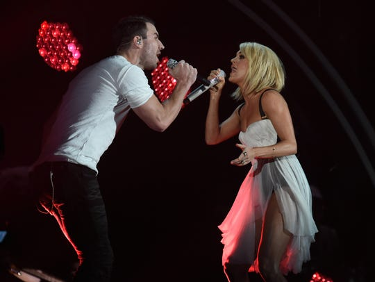 Sam Hunt (left) and Carrie Underwood mash up their