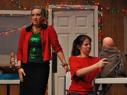 Louisiana College student Rose Smoak (left) and alum Bekah Unsworth rehearse Tuesday night for theatre louisiana college's production of Christmas Belles.