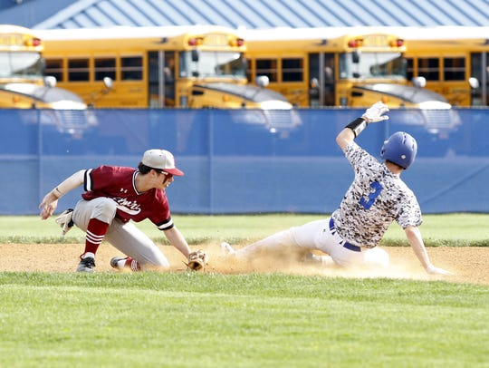 Mike Limoncelli of Horseheads slides safely into second