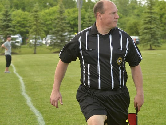Soccer referee Jeff Vakratsis played in the first Canton