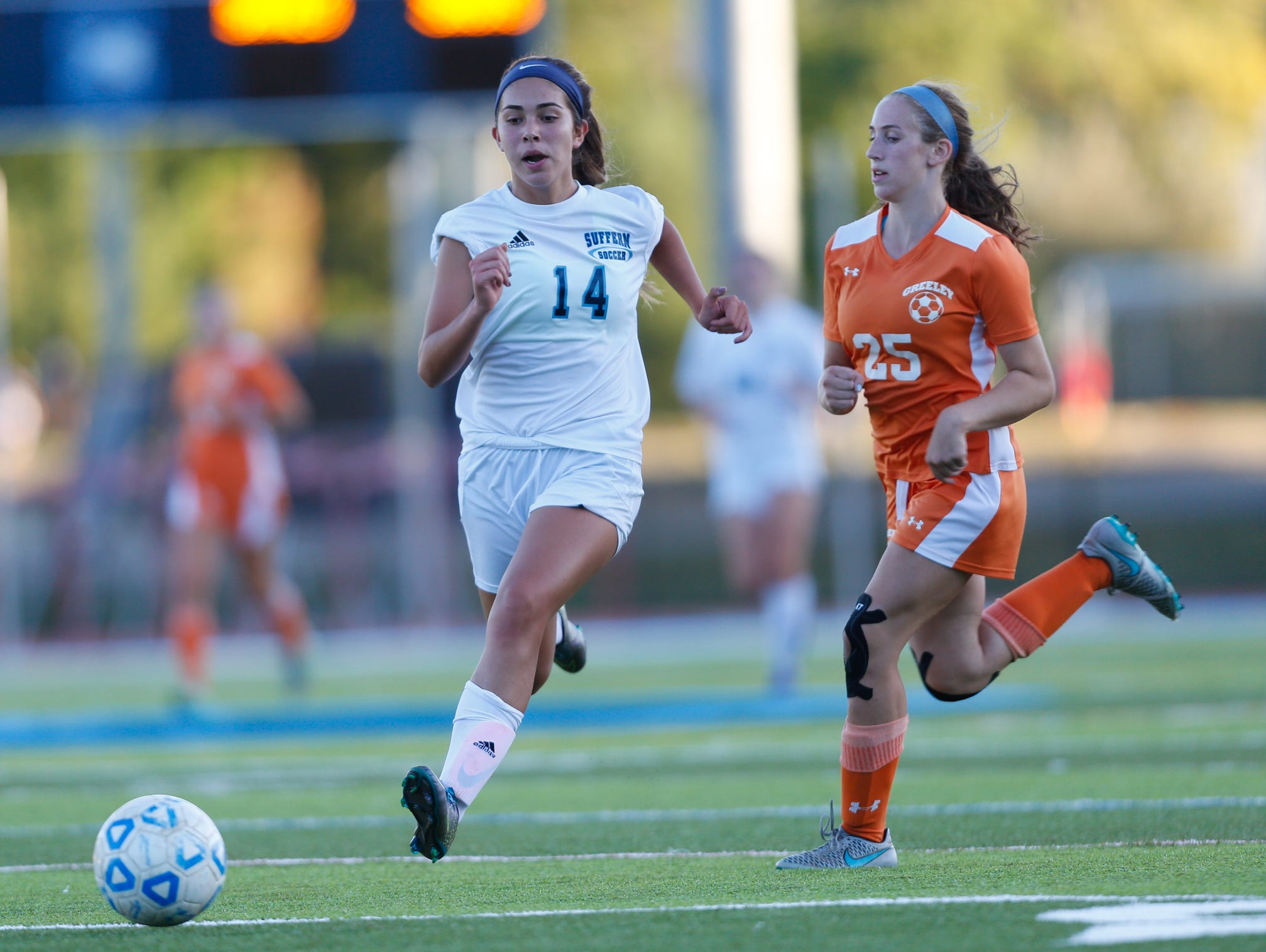 Tatiana Cruz (14) works the ball during their game against Horace Greeley at Suffern Middle School on Thursday, September 15, 2016.