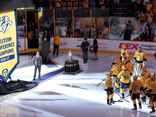 Former captain Mike Fisher and current captain Roman