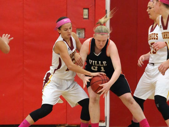 Somerville vs Voorhees girls basketball held at Voorhees High School in Glen Gardner on Tuesday January 19, 2016.Voorhees # 12 (left) Allie Best battles with Somerville's # 31 (right) Meghan Douglas for a loose ball