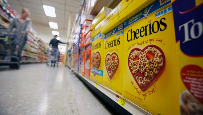 General Mills, maker of Cheerios and other popular brands like Yoplait, will start labeling all of its products with genetically modified ingredients.